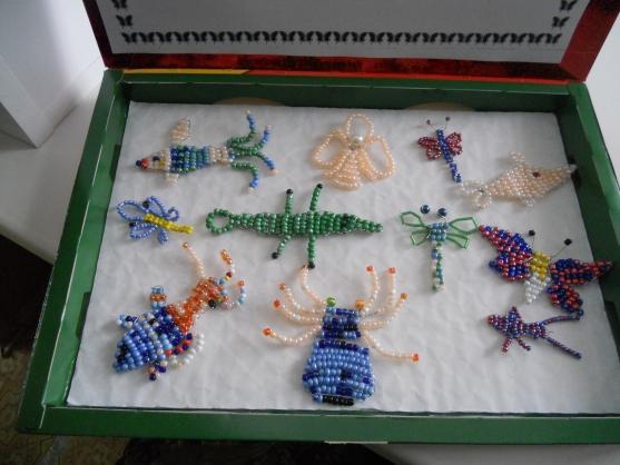 И мы предложили детям бисероплетение.  Подарки сделать мамам - ангелочков, а... Персональная выставка воспитанника.