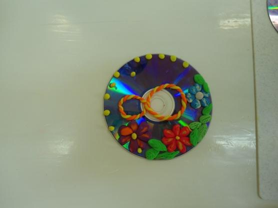 Поделки из дисков своими руками маме