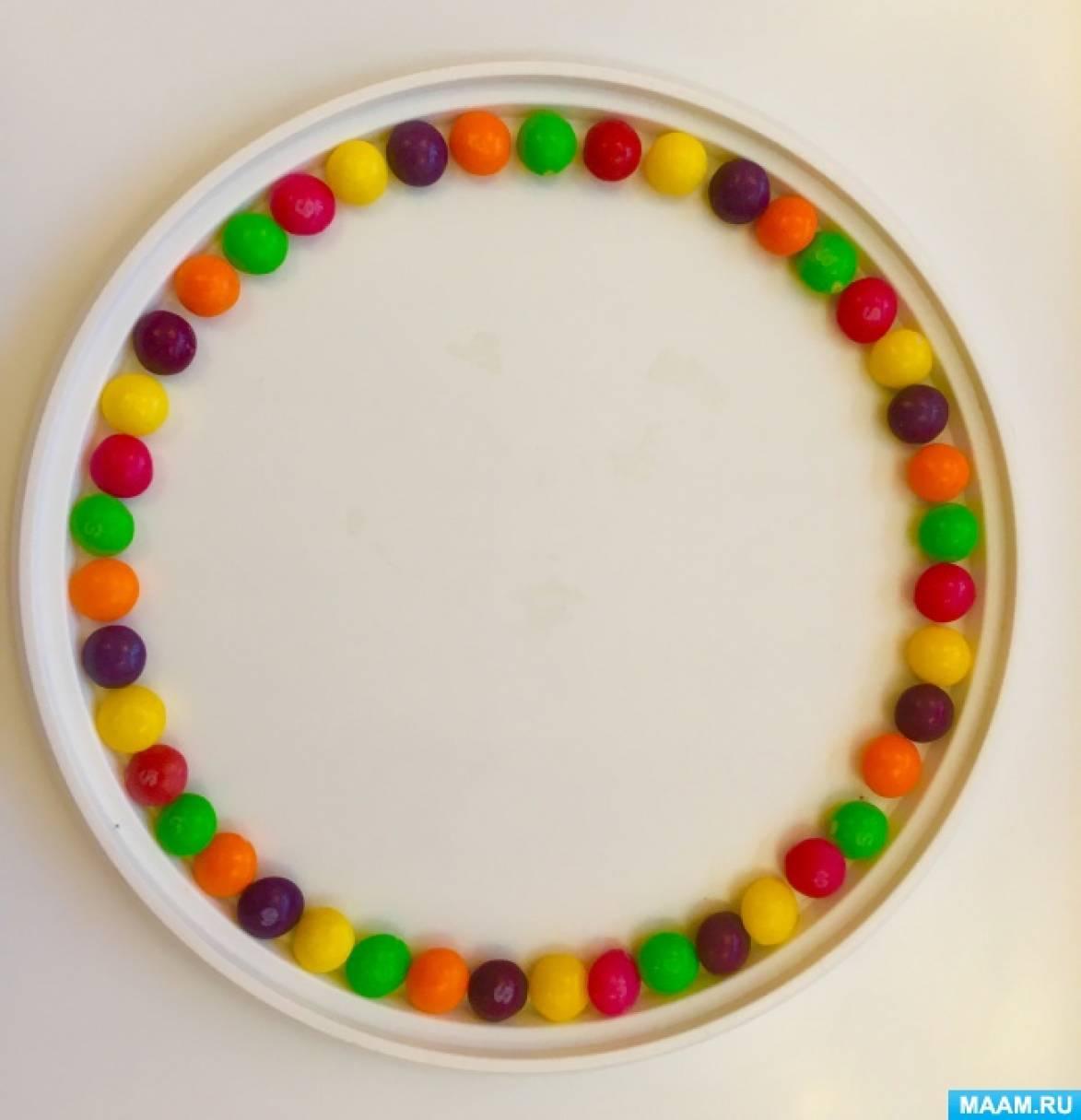 Опытно-экспериментальная деятельность в средней группе «Радуга в тарелке из разноцветных конфет»