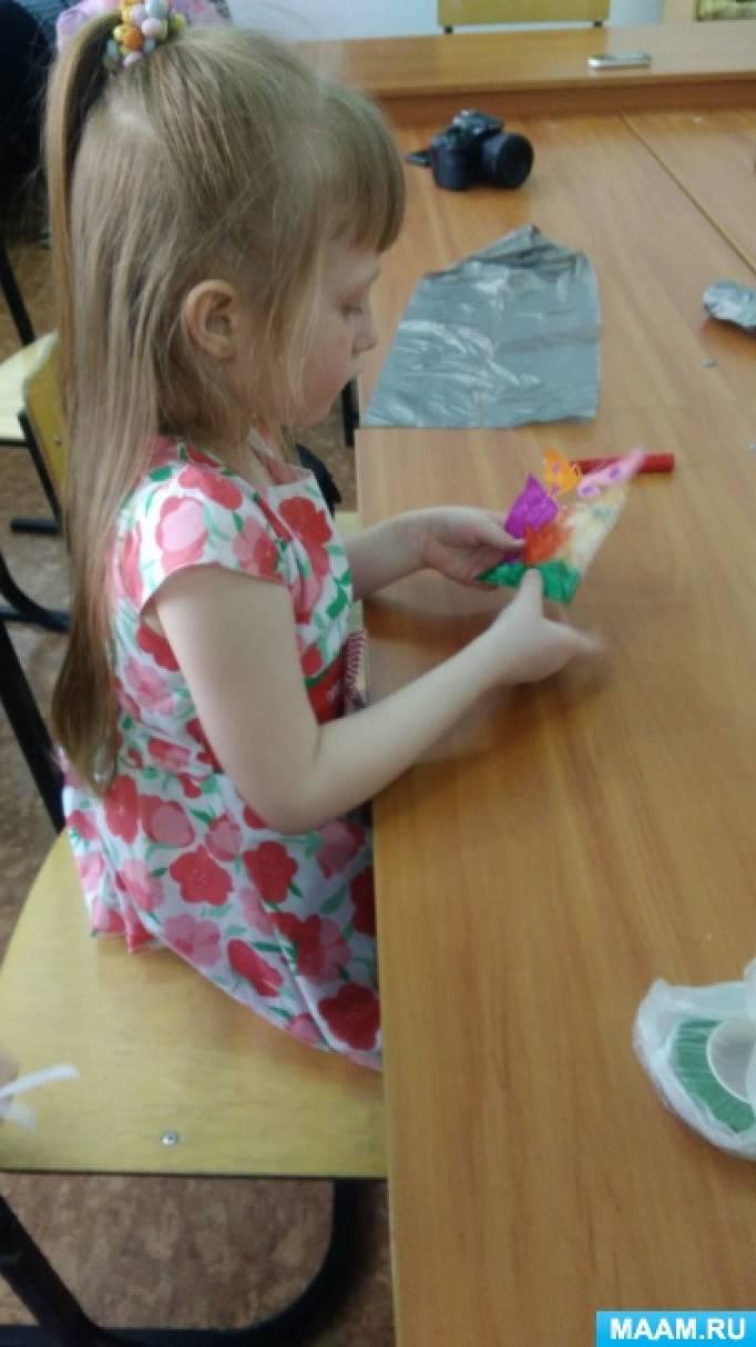 Мастер-класс по выполнении цветов из мусорных пакетов