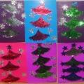 Аппликация «Новогодние ёлочки!» из новогодних украшений.