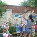 Фотоотчет о летнем развлечении в 1-ой младшей группе «В гостях у солнышка»