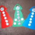 Дидактическая игра по обучению детей грамоте «Подари кукле пуговку»