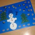 Коллективная работа в первой младшей группе «Летят снежинки»