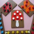 Дидактическая игра «Разноцветные крышечки»
